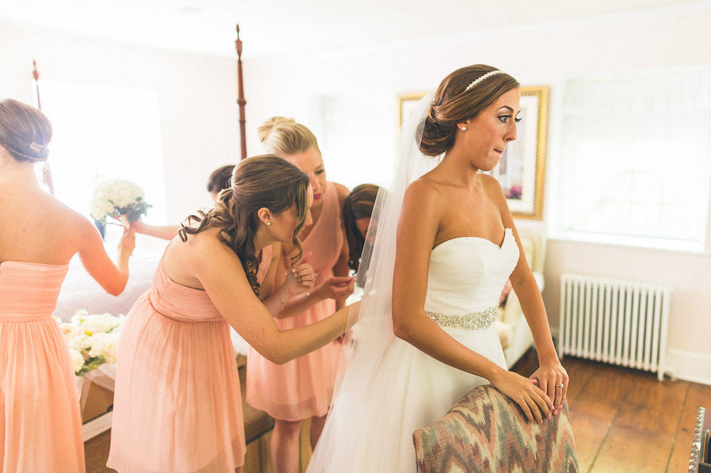 Bridesmaids help Bride