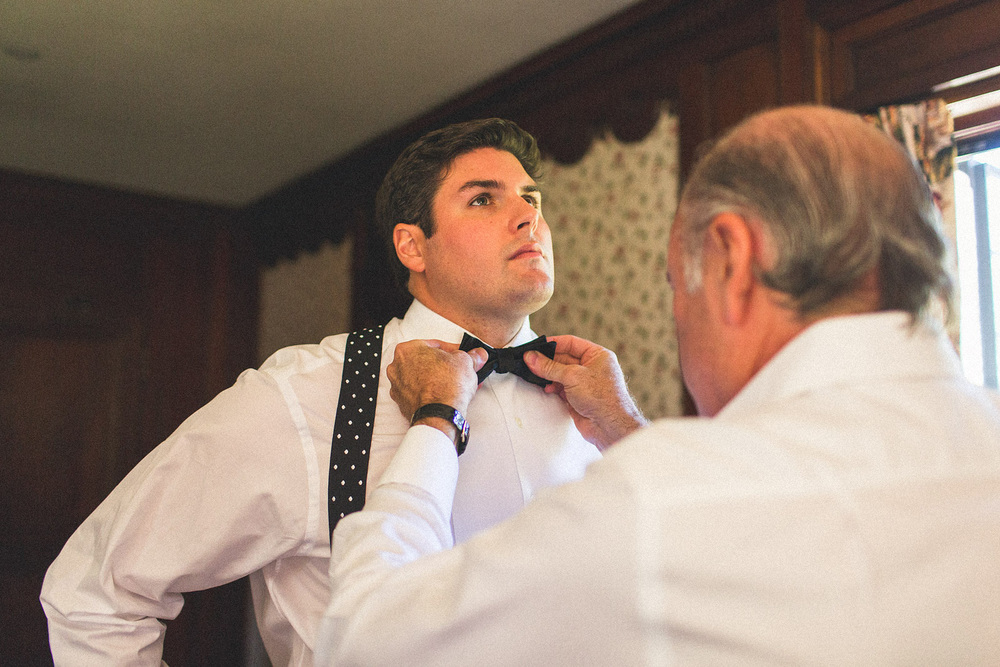 Father adjusts Grooms Tie