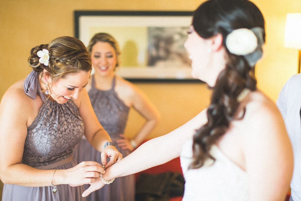 Girls help Bride with Jewelry
