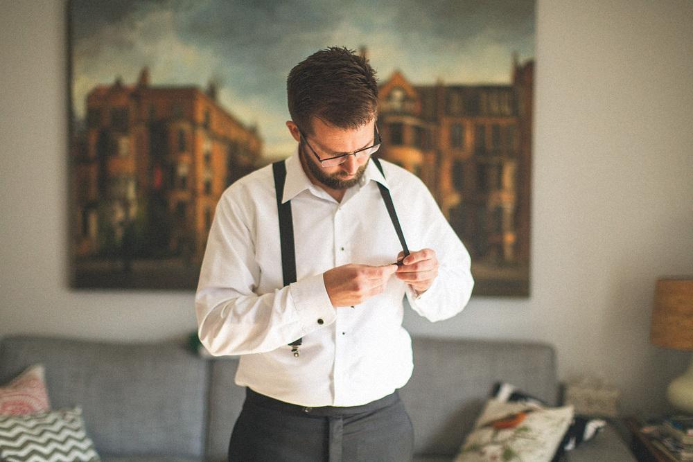 Groom adjust suspenders