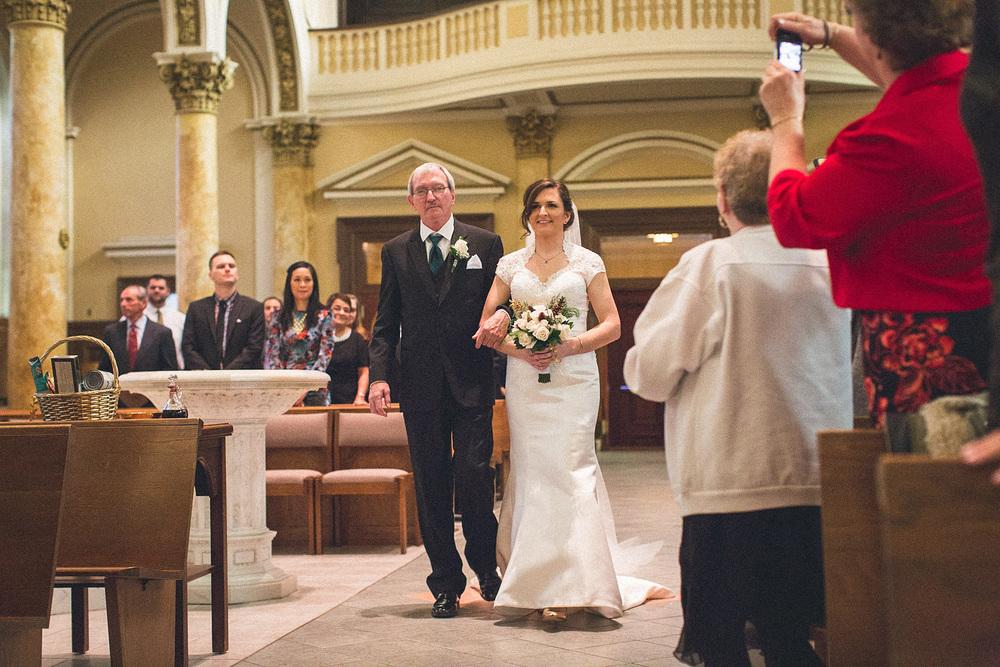 Bride Walks Down Isle