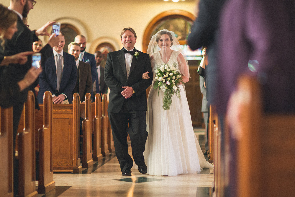 Bride walks down isle with father