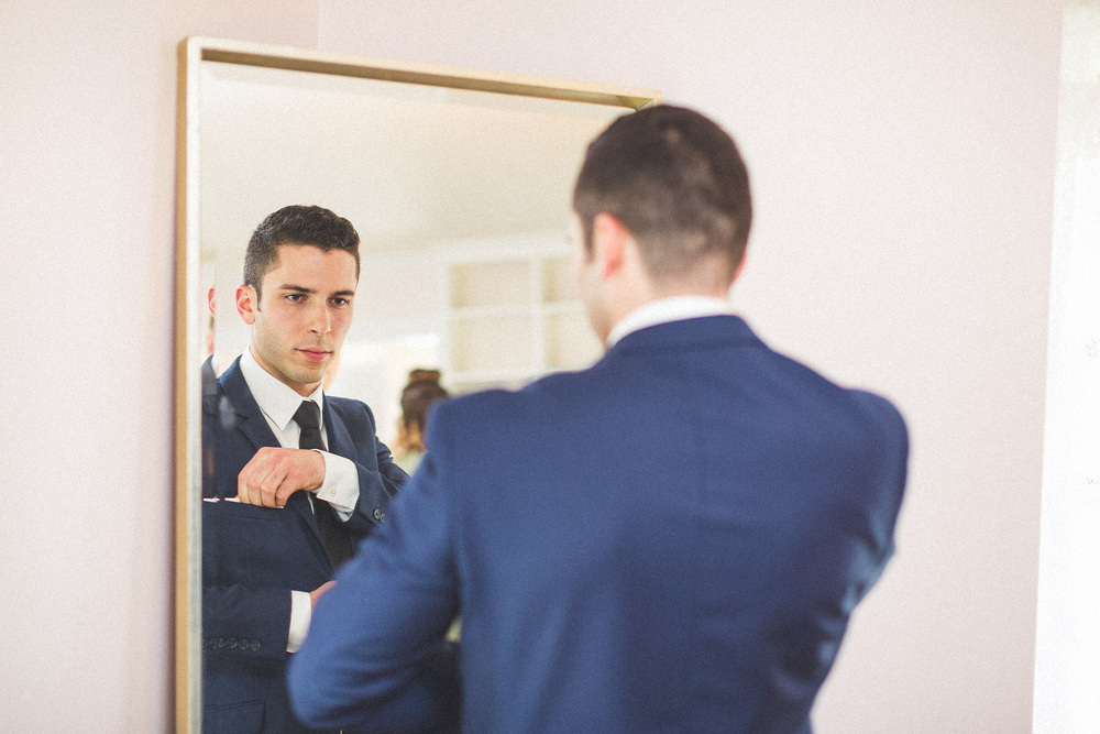 Groom puts in Pocket Square