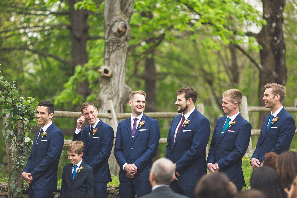 Guys laugh at Ceremony