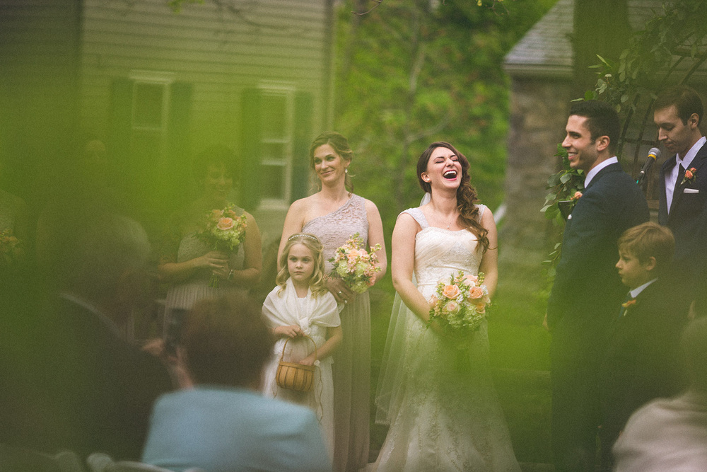 Bride laughs hard at joke
