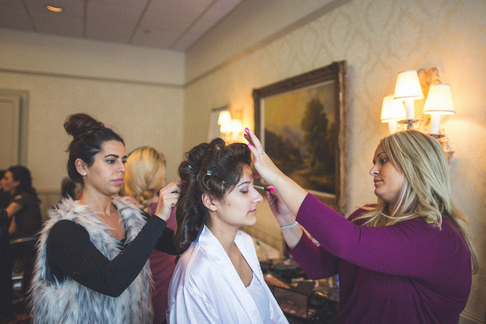 Bride getting make up and hair