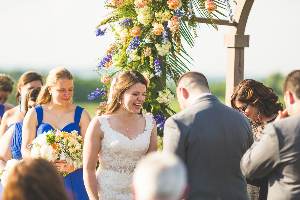 Bride laughs at Groom