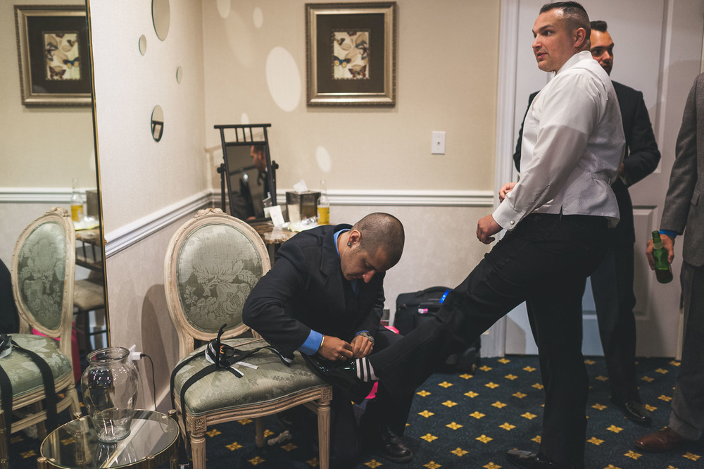 Groom gets his shoes tied