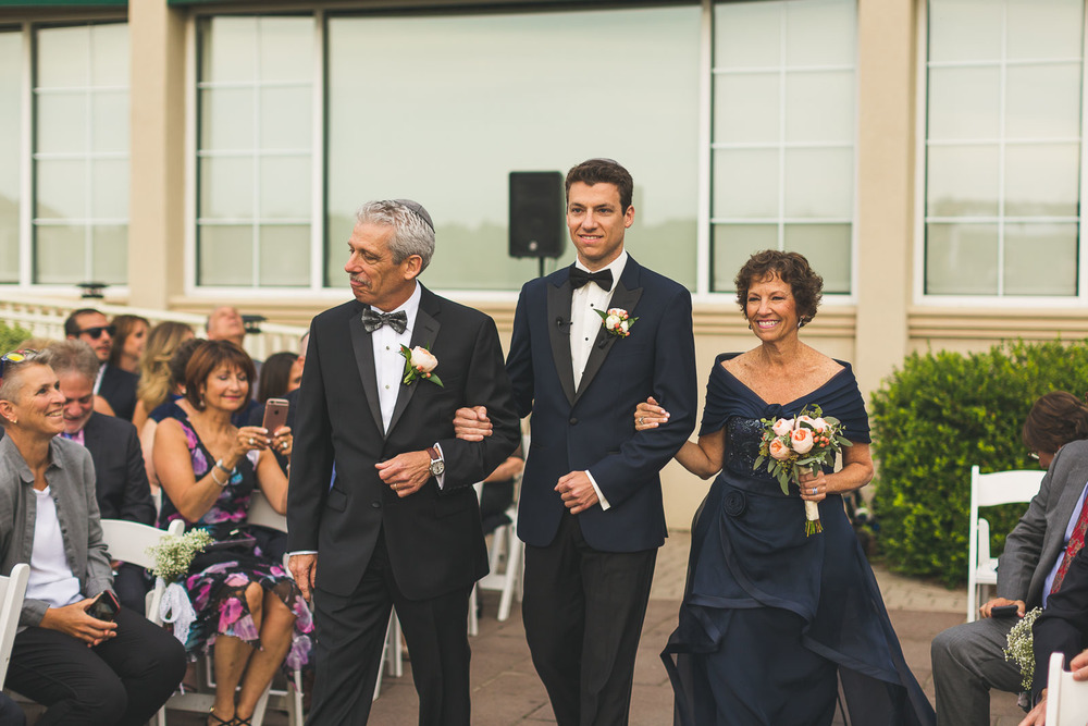 Groom Walks down aisle with Parents