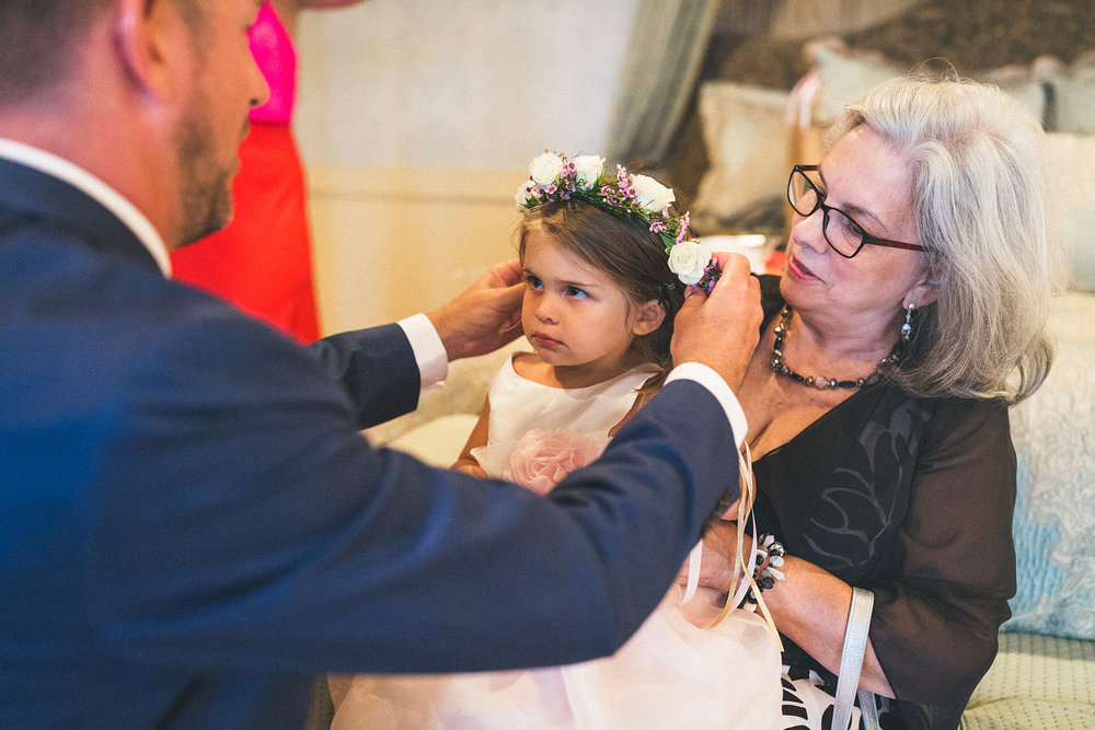 Flower girl is not happy with flower crown