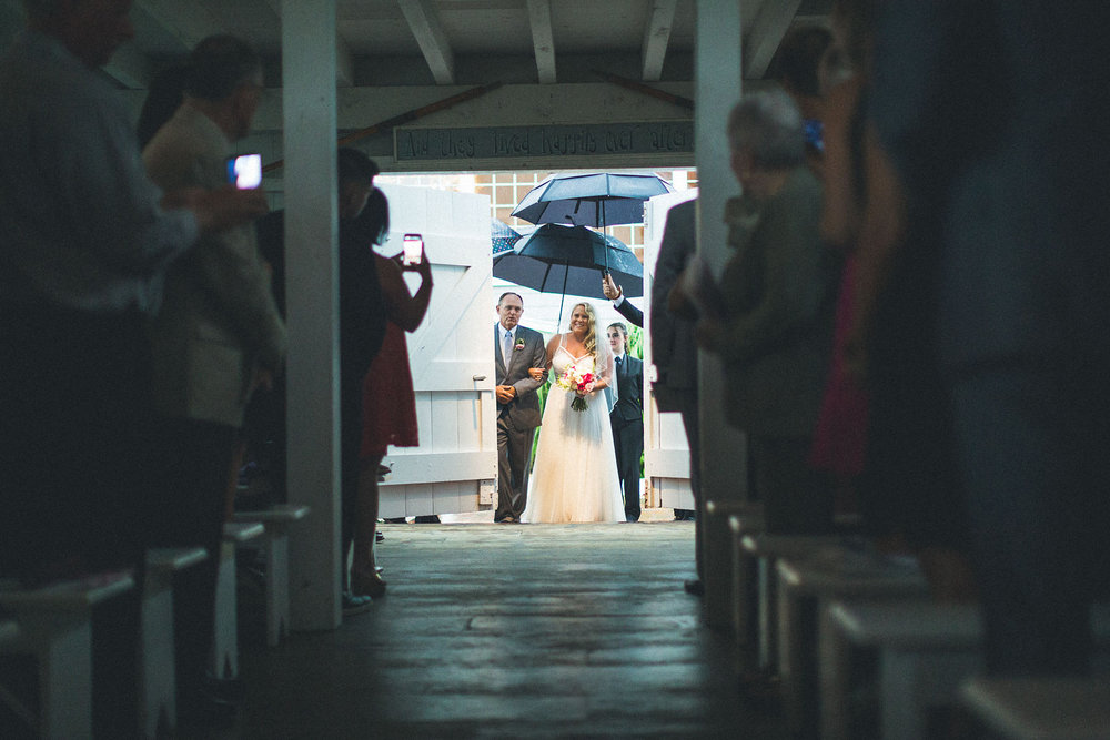 Bride enters barn chapel with dad