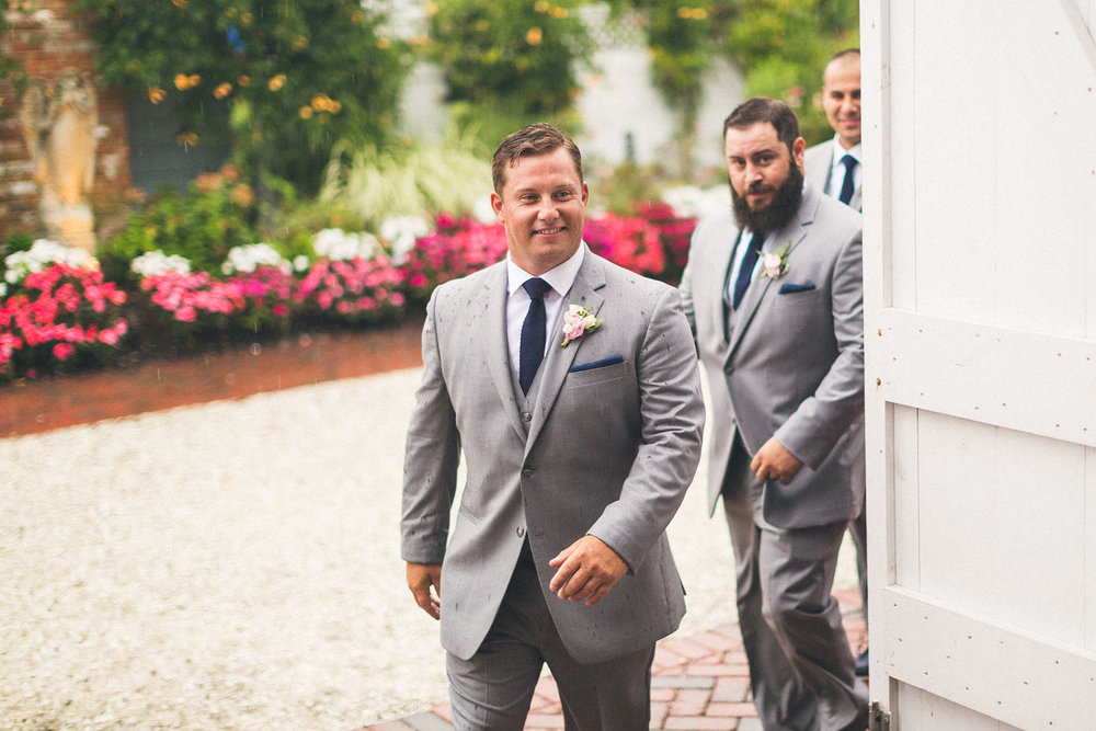 Groom walks into wedding ceremony
