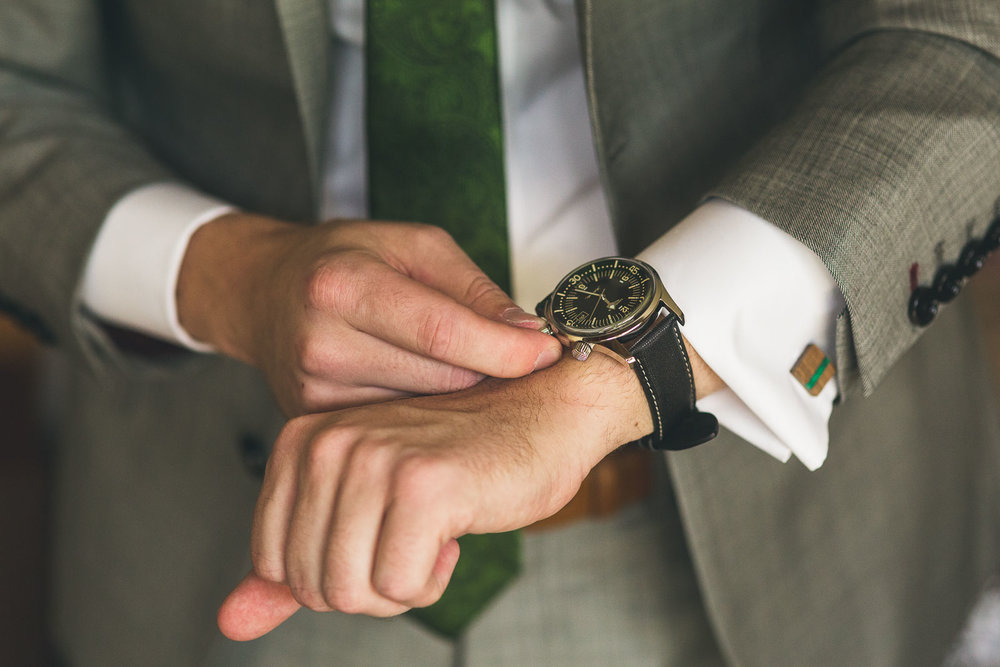 Groom tries on watch