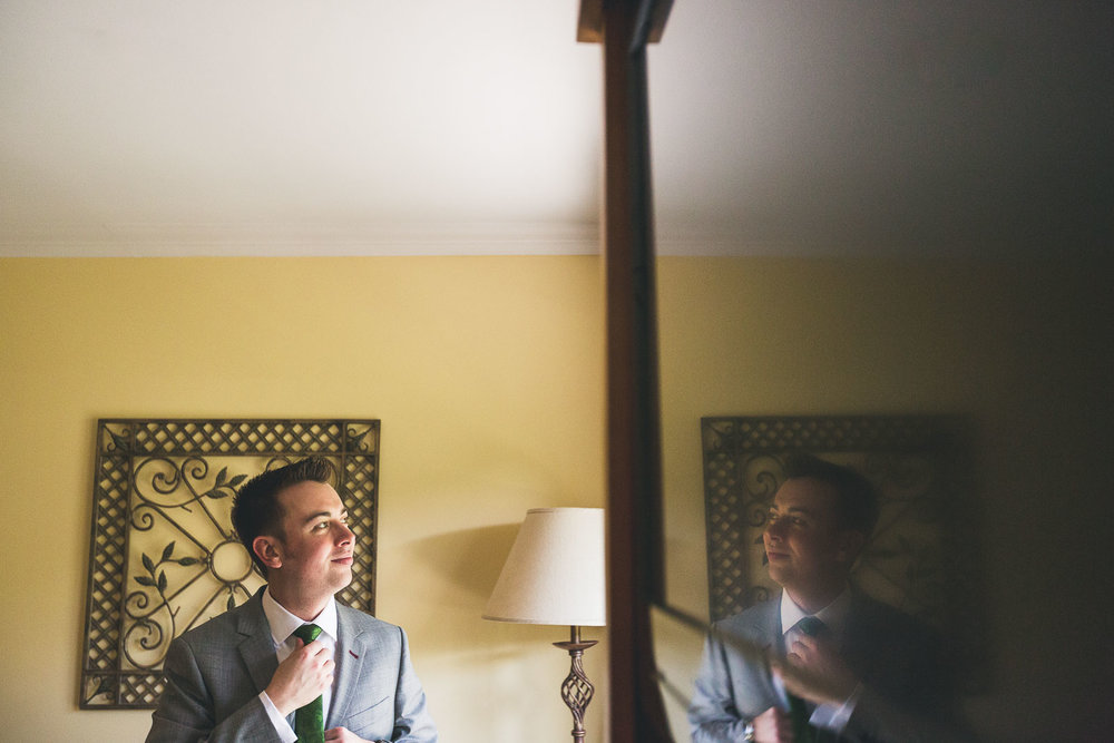 Groom gets ready at Mineral Resort and Spa