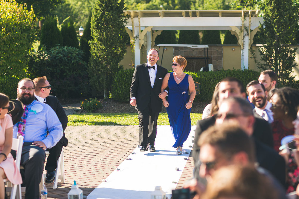 Groom walks down aisle with mom