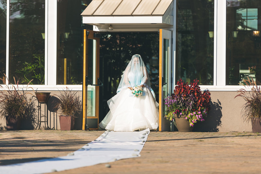 Bride walks down aisle