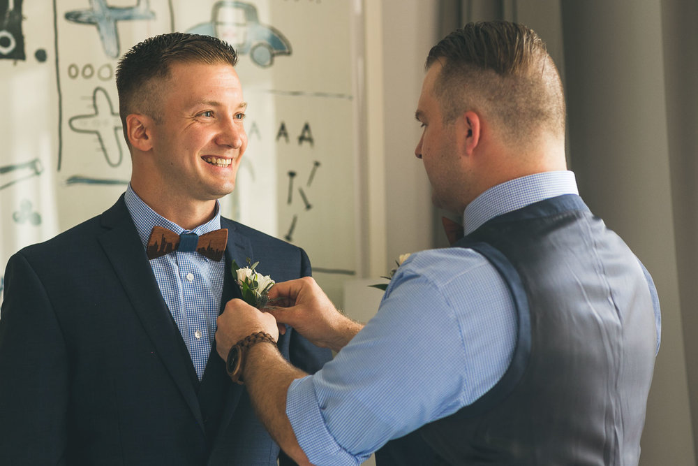Best man helps groom