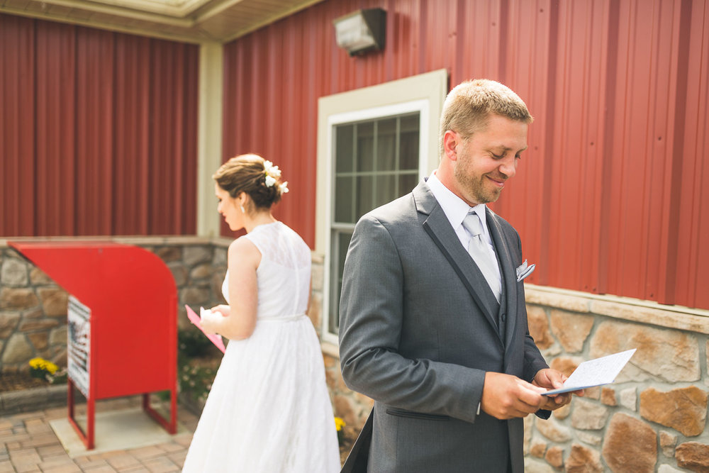 Groom reads letter from bride