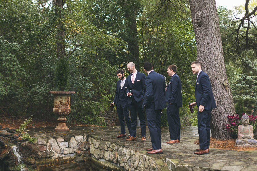 Groom admires pond