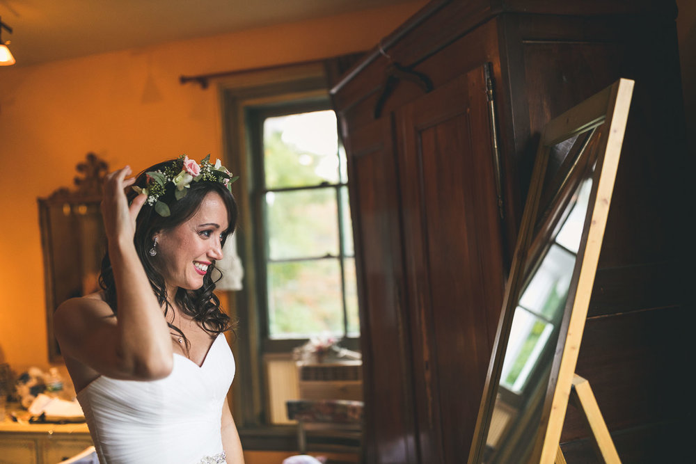Bride puts flower crown on