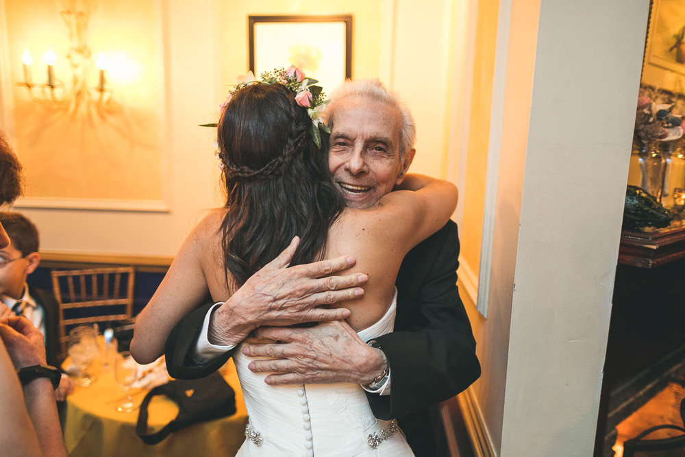 Grandfather hugs Granddaughter