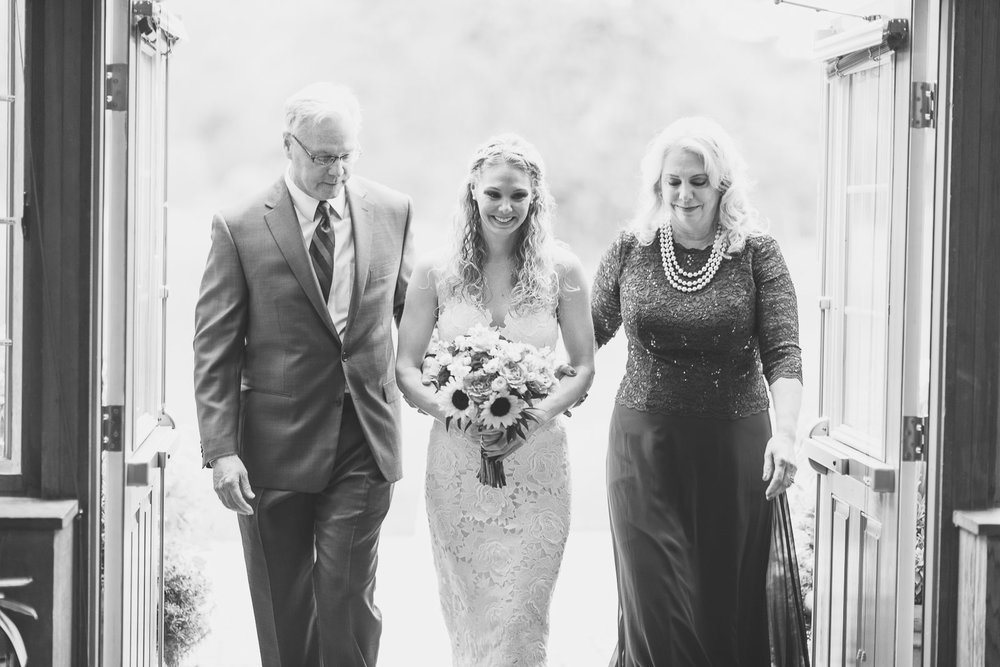 Bride enters with parents