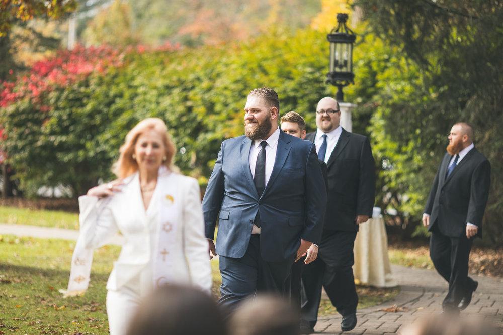 Groom enters Ceremony