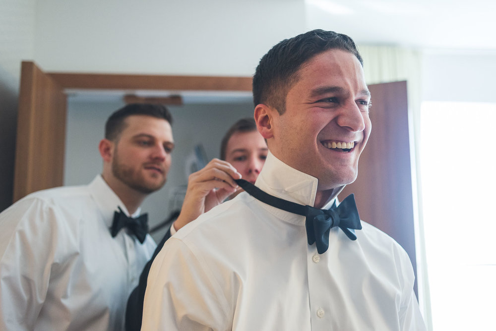 Groom gets bow tie
