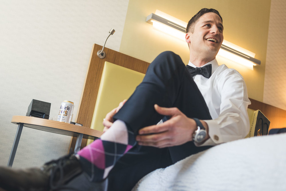 Groom puts on fancy socks