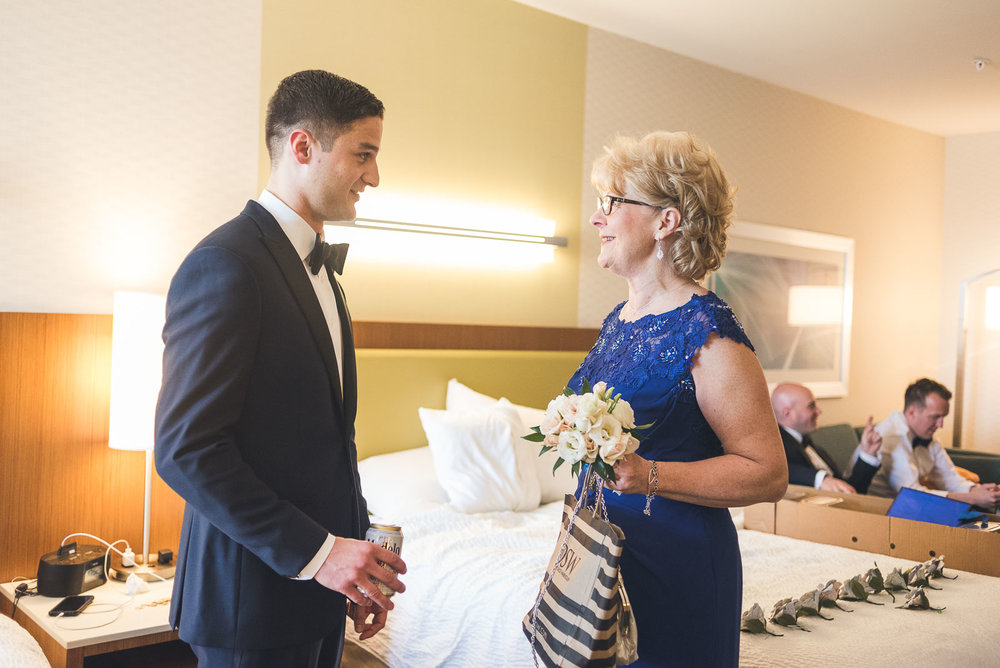 Groom and Mother talk before wedding