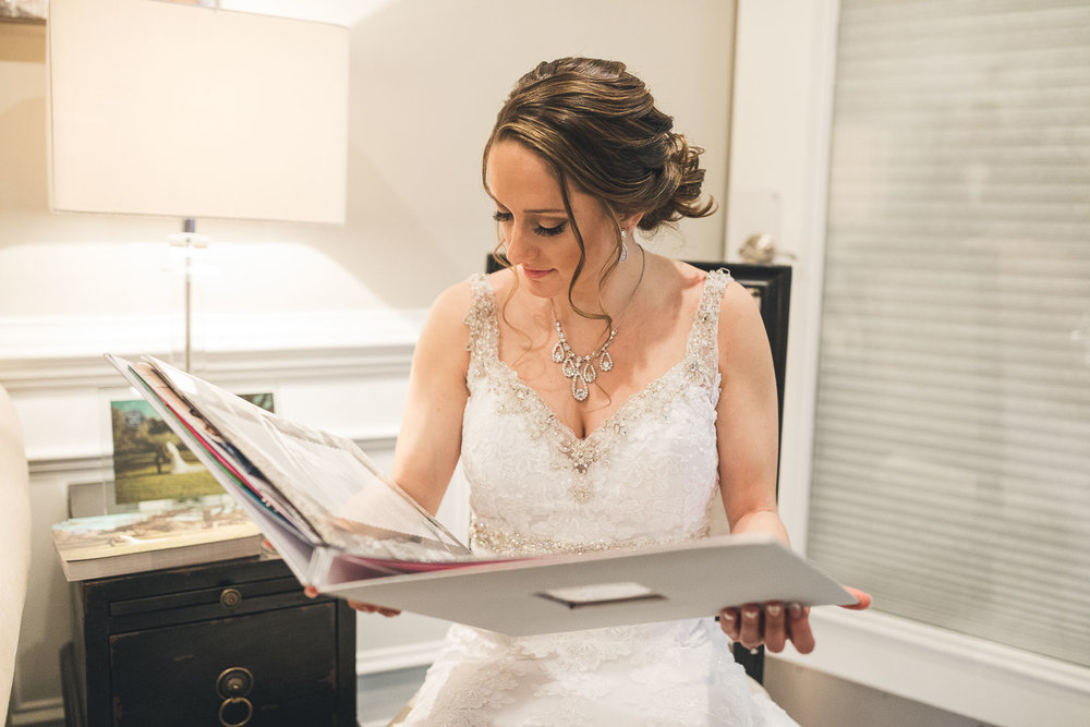 Bride looks at Gift