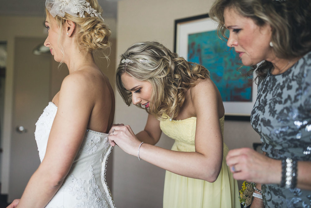Sister and Mom help with Brides Dress