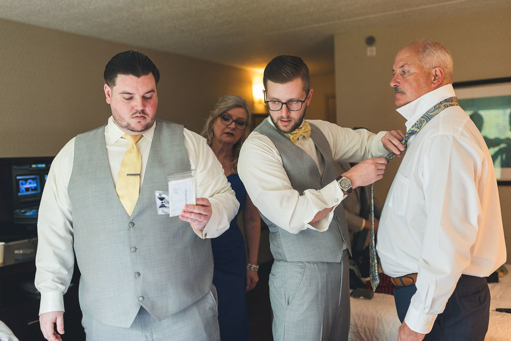 Family contemplates the pocket square