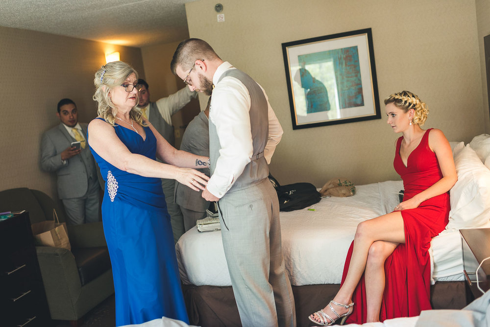 Mom helps Groom with Sister