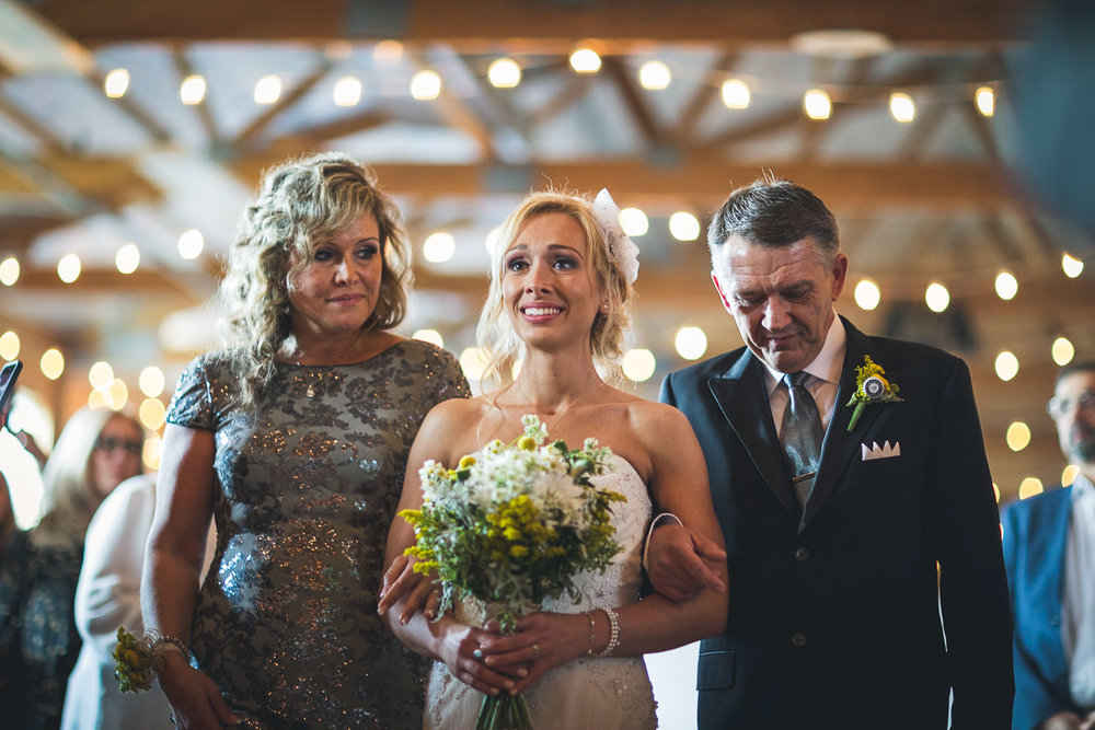 Mom and Dad walk bride down aisle