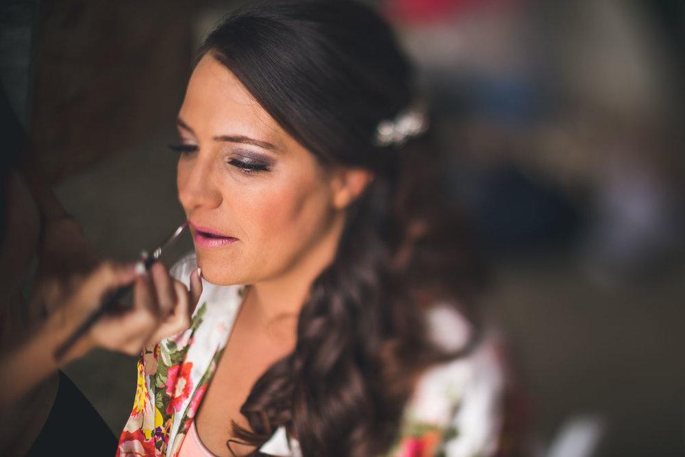 Applying lipstick on bride