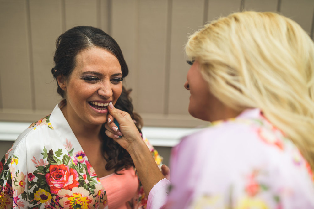 Bridesmaid helps clean teeth of Bride