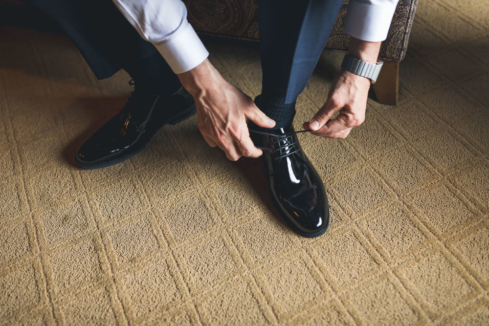 Lacing up Grooms shoes