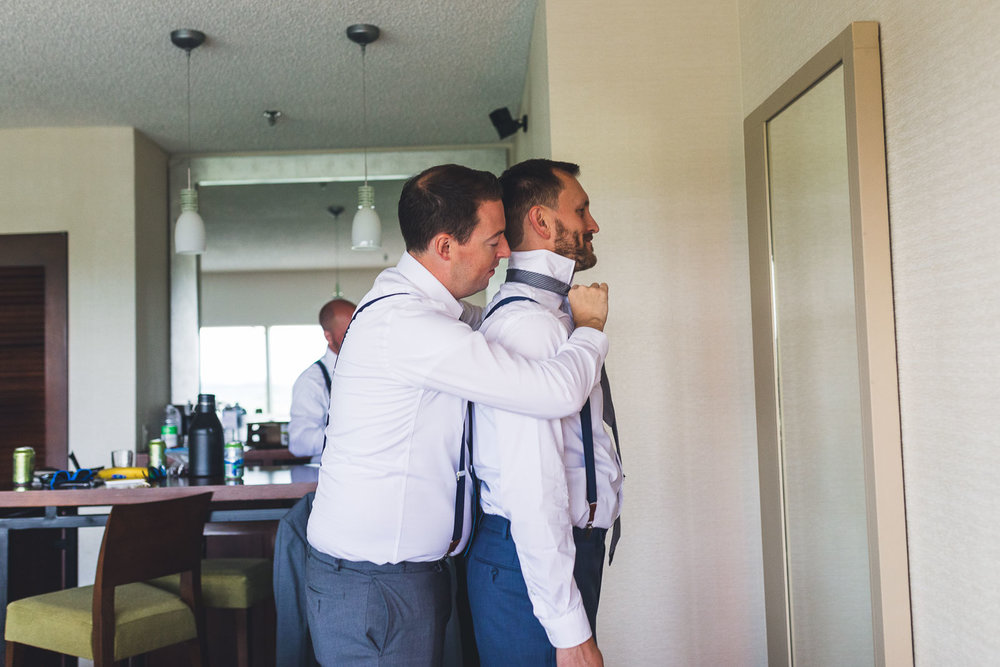 Groom gets help with his tie