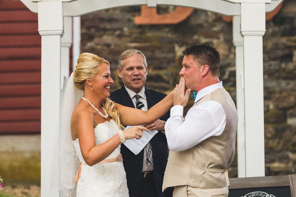 Bride wipes makeup off groom