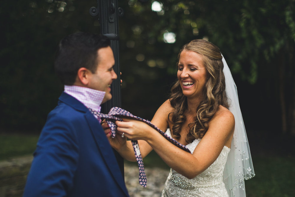 Bride helps groom with Tie