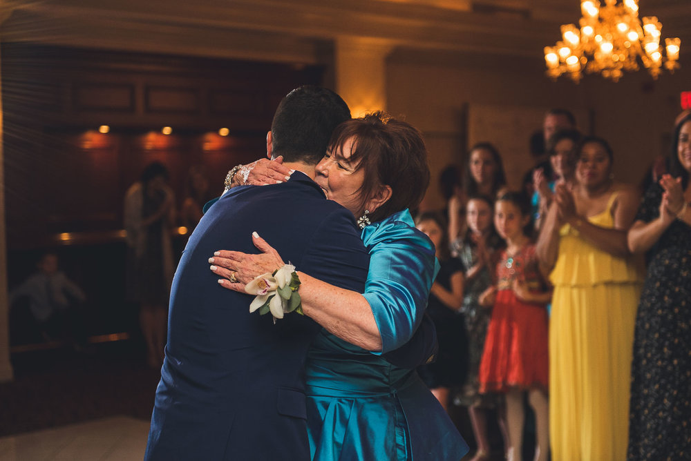 Groom hugs Mom