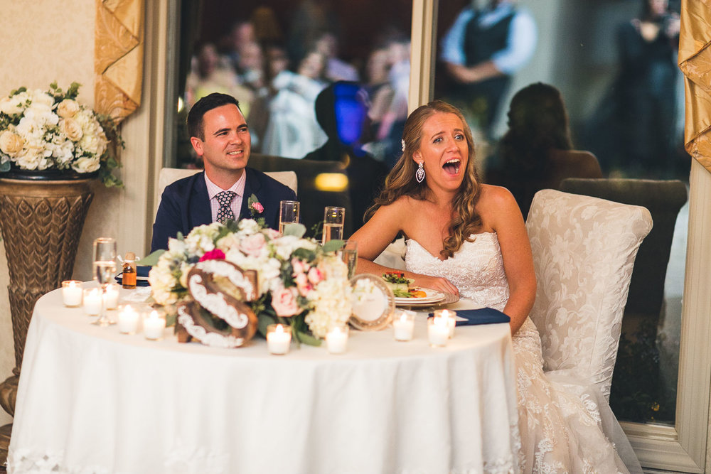 Bride laughs at joke