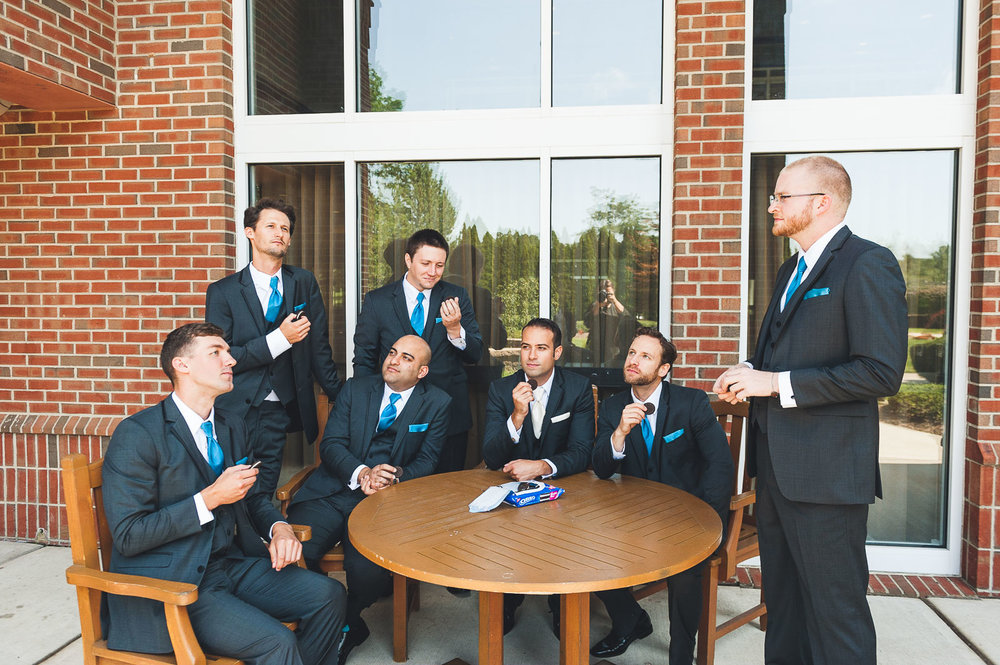 Groomsman enjoy some Oreos