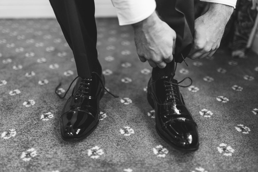 Groom ties shoes