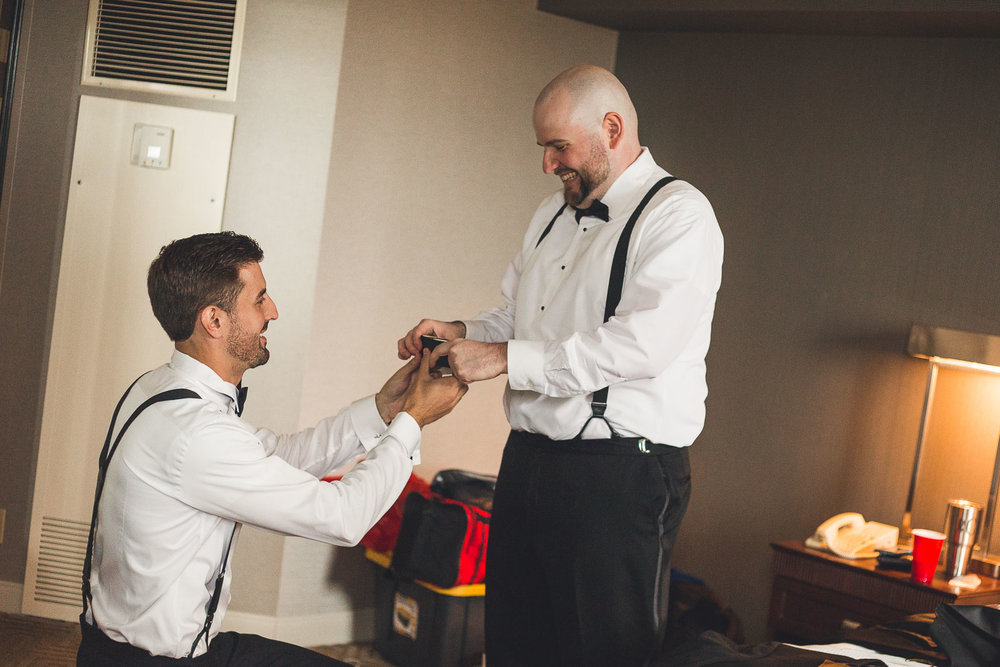 Groom gives bestman cuff links