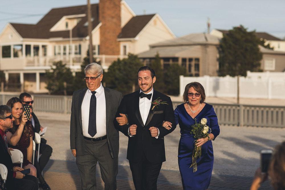 Parents walk Groom down aisle