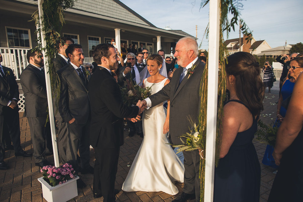Groom shakes hand with brides father