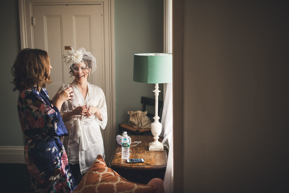 Bride laughs with sister