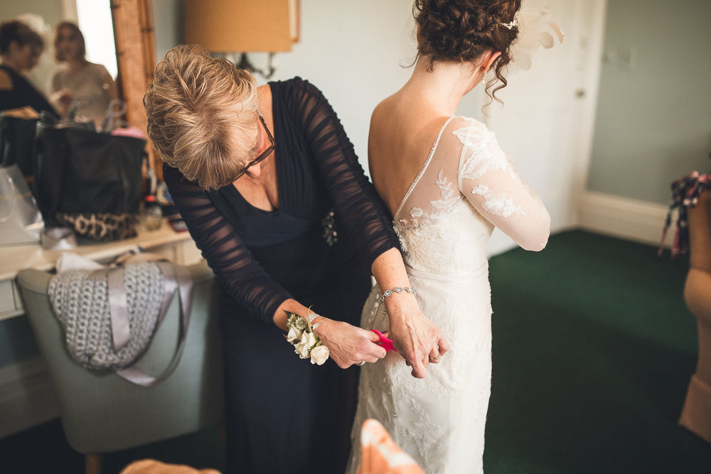 Mom does last minute alterations to the dress